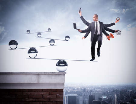 Foto de Businessman balancing on boards with iron balls - Imagen libre de derechos