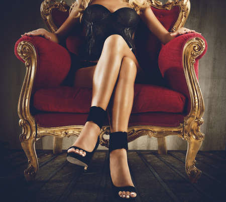 Photo for Woman in lingerie sitting on an armchair - Royalty Free Image