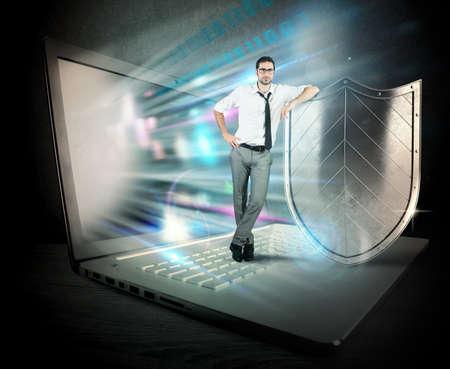 Foto de Small confident businessman with computer and shield - Imagen libre de derechos