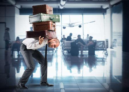 Photo pour Businessman with so many suitcases inside airport - image libre de droit