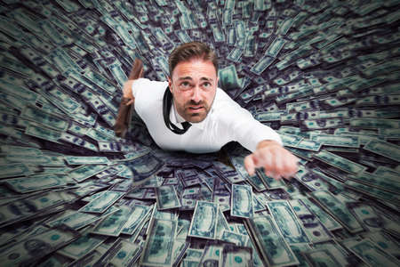 Photo pour Hole that sucks a businessman and money - image libre de droit