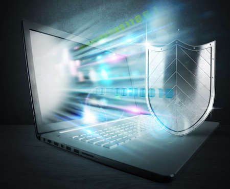 Foto de Concept of antivirus with computer and shield - Imagen libre de derechos