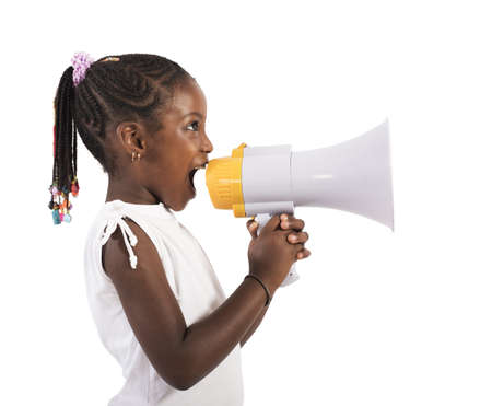 Photo pour Little girl screaming and shouting with megaphone - image libre de droit