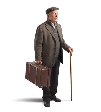 Photo pour Old man walk with suitcase and stick - image libre de droit