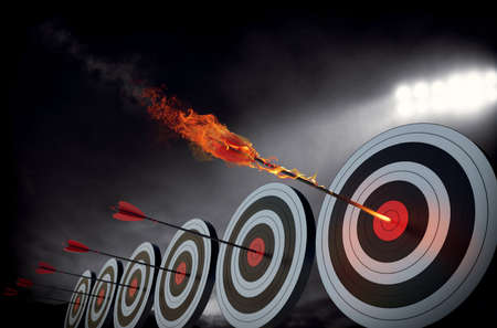 Photo for Flaming arrow hitting the center of target - Royalty Free Image
