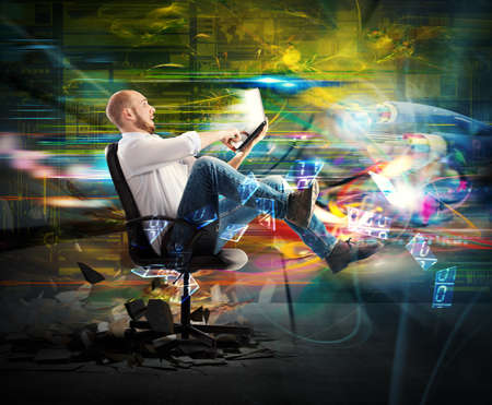 Foto per Amazed businessman quickly transported from his laptop - Immagine Royalty Free