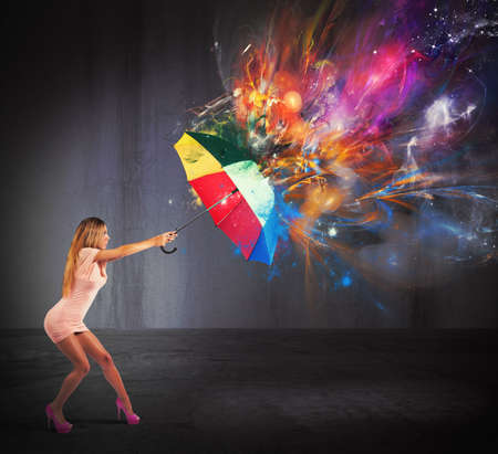 Photo pour Sexy woman protect against a colors explosion - image libre de droit