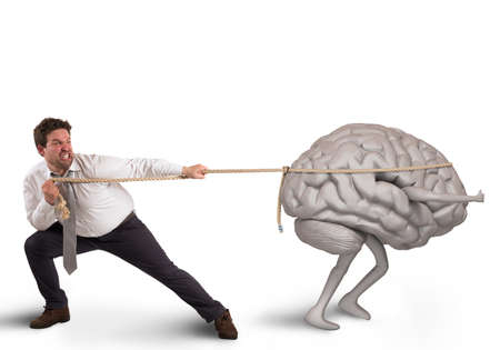 Foto de Man pulls the rope with brain drain - Imagen libre de derechos