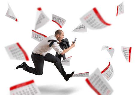 Photo pour Man runs screaming with calendar sheets background - image libre de droit
