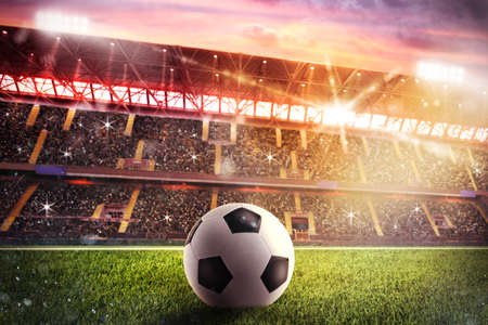 Photo pour Soccerball on the lawn of a stadium - image libre de droit