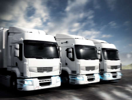 Foto de Three white articulated trucks on the road - Imagen libre de derechos