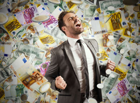 Photo for Concept of success and career of a businessman with rainy banknotes - Royalty Free Image