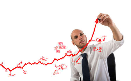 Foto de Businessman draw graphics on an arrow uphill - Imagen libre de derechos
