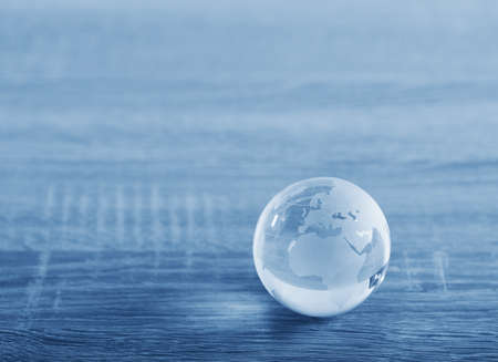 Photo pour World glass sphere with continents on the table - image libre de droit