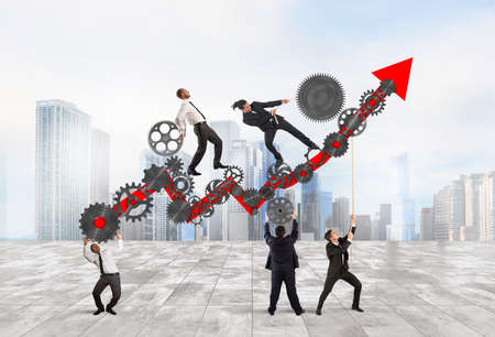 Foto de Teamwork build an arrow upwards with gears mechanism - Imagen libre de derechos