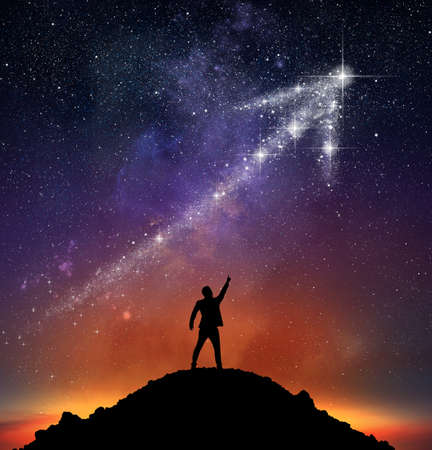 Foto de Businessman on a mountain indicate an arrow with stars - Imagen libre de derechos