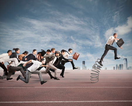 Photo pour Businessman jumping on a spring during a race with opponents - image libre de droit