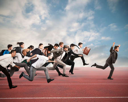 Photo for Businessman exults winning during a race with opponents - Royalty Free Image