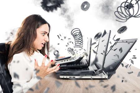 Foto de Businesswoman with worried expression with computer exploded - Imagen libre de derechos
