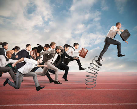 Photo for Businessman jumping on a spring during a race with opponents - Royalty Free Image