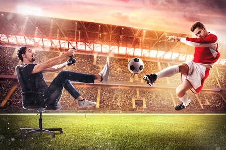 Foto de Boy with joystick plays with soccer video game - Imagen libre de derechos