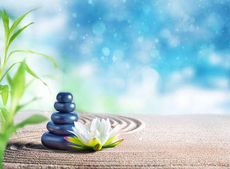 Foto de Therapy relaxing spa treatment with oriental stones on the sand - Imagen libre de derechos