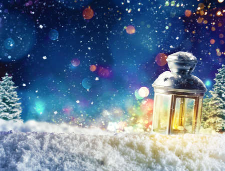 Foto de Xmas decoration background with lantern on snow - Imagen libre de derechos