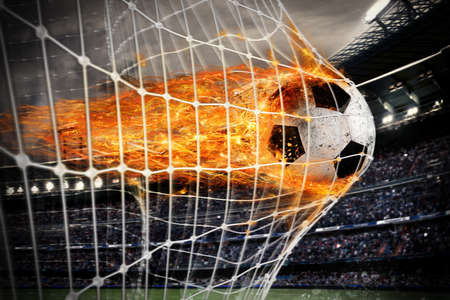 Photo pour Soccer fireball scores a goal on the net - image libre de droit