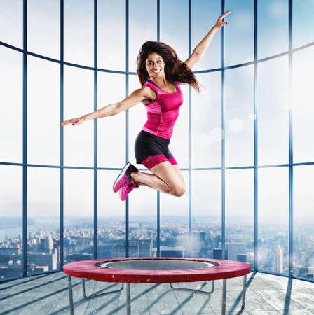 Foto de Fitness teacher jump at the modern gym - Imagen libre de derechos