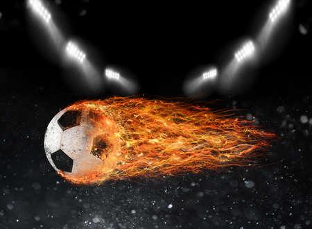 Photo pour Soccer ball of fire at the stadium - image libre de droit