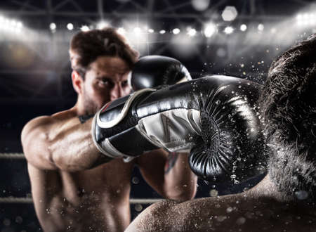 Photo for Boxer in a boxe competition beats his opponent - Royalty Free Image