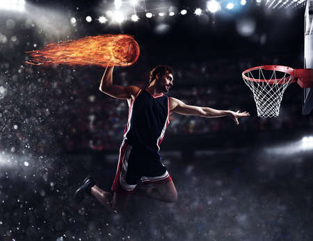 Photo pour Basket player throws the fireball at the stadium - image libre de droit