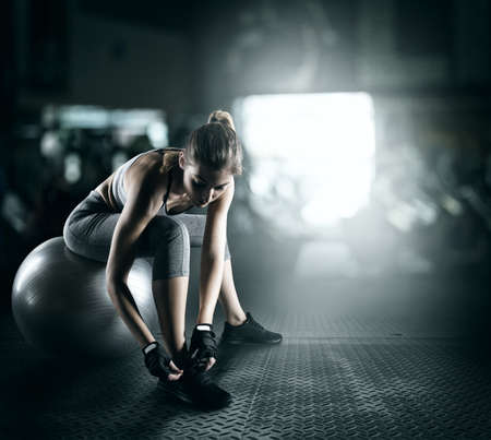 Photo pour Workout with fitness ball - image libre de droit
