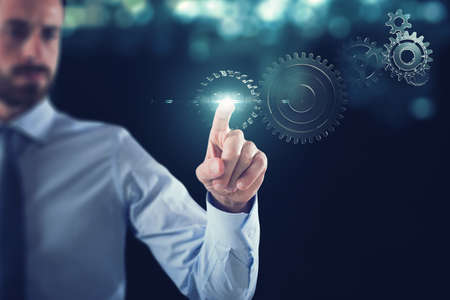 Foto de Business work  with gears mechanism - Imagen libre de derechos