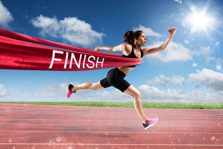 Photo pour Winner woman runner on the finish line - image libre de droit