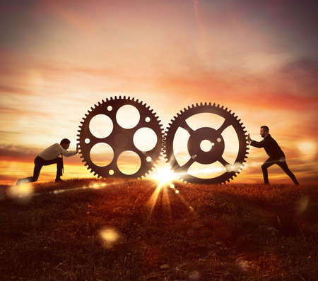 Photo pour Cooperation at work concept with gears mechanism - image libre de droit