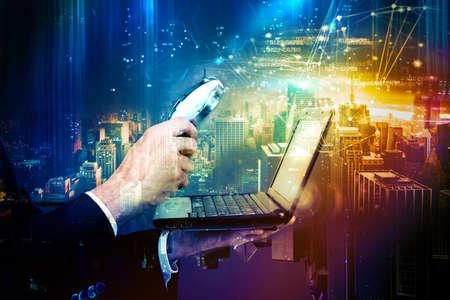 Foto de Examine a computer with magnifying glass - Imagen libre de derechos