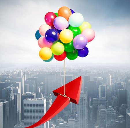 Photo pour Arrow raised by flying balloons. fly to economic success - image libre de droit