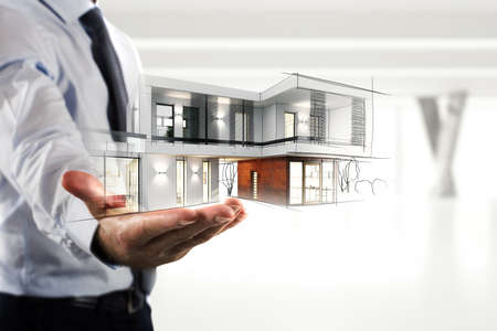 Foto de Businessman showing a modern office project - Imagen libre de derechos