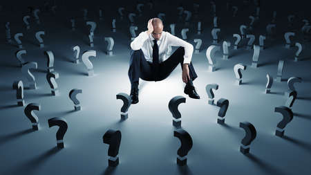 Photo for Businessman with many question marks. Concept of failure and problem - Royalty Free Image