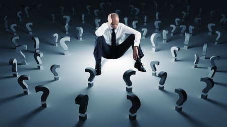 Foto de Businessman with many question marks. Concept of failure and problem - Imagen libre de derechos