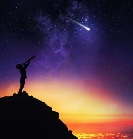 Foto de Child observes starry sky with a telescope - Imagen libre de derechos