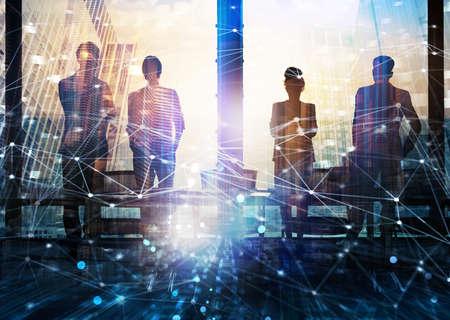 Foto de Group of business partner looking for the future with network digital effect - Imagen libre de derechos