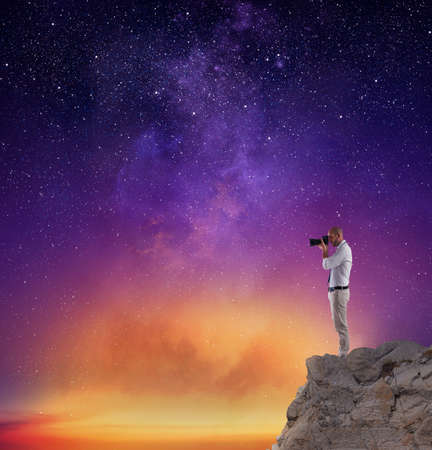 Photo for Photographer take a photo in a night sky full of stars - Royalty Free Image