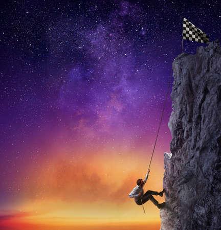 Foto de Businessman climb a mountain to get the flag. Achievement business goal and difficult career concept - Imagen libre de derechos