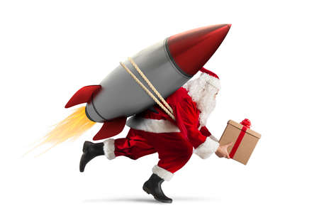 Photo pour Fast delivery of Christmas gifts ready to fly with a rocket isolated on white background - image libre de droit