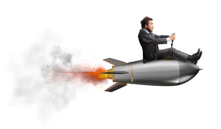 Foto de Businessman flying over a rocket. concept of company startup - Imagen libre de derechos