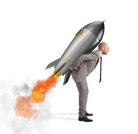 Photo for Determination and power businessman that holds a rocket isolated on white background - Royalty Free Image