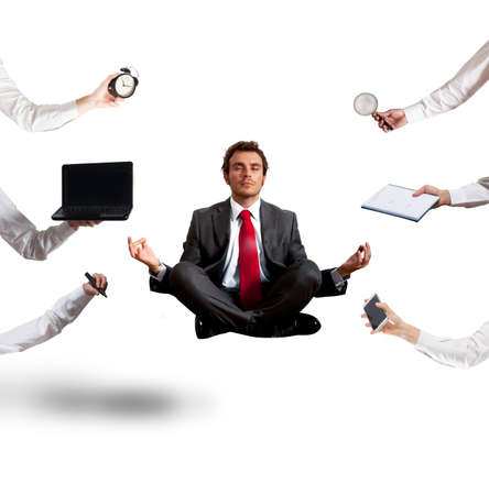 Photo pour Relaxed businessman that does yoga during the work - image libre de droit