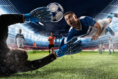 Photo pour Goalkeeper catches the ball in the stadium - image libre de droit